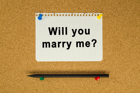 Will you marry me text note message pin on bulletin board