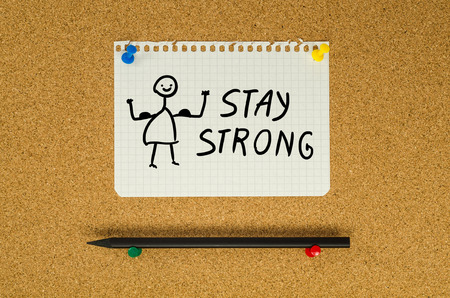 strong message: Stay strong text note message pin on bulletin board