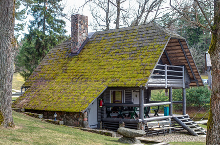 bathhouse: The old bathhouse in rural. The roof overgrown with moss. Stock Photo