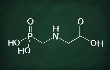 Structural model of glyphosate molecule on the blackboard. Stock Photo