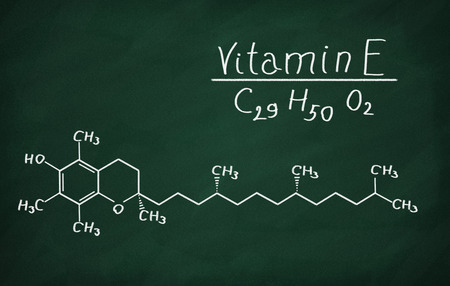 structural: Structural model of Vitamin E (tocopherol) on the blackboard.