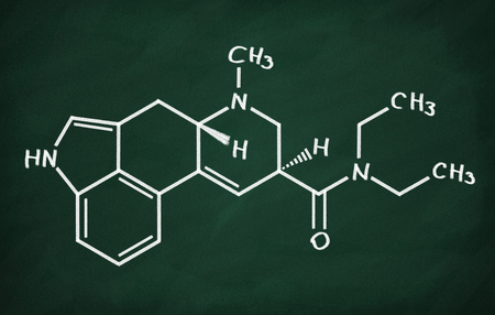 psychoactive: Structural model of LSD on the blackboard. Stock Photo