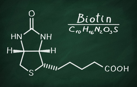 biotin: Structural model of Vitamin B6 (Biotin) on the blackboard. Stock Photo