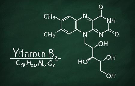 riboflavin: Structural model of Vitamin B2 (Riboflavin) on the blackboard. Stock Photo