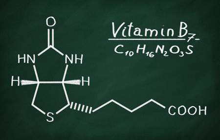 Structural model of Vitamin B6 (Biotin) on the blackboard. Stock Photo