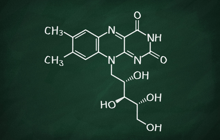 structural: Structural model of Vitamin B2 (Riboflavin) on the blackboard. Stock Photo