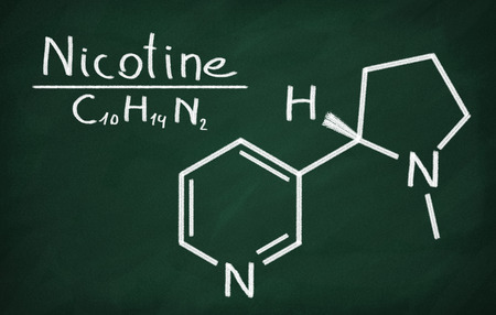 structural: Structural model of Nicotine on the blackboard. Stock Photo