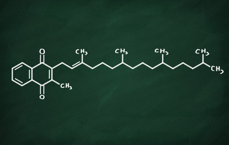 structural: Structural model of Vitamin K on the blackboard. Stock Photo