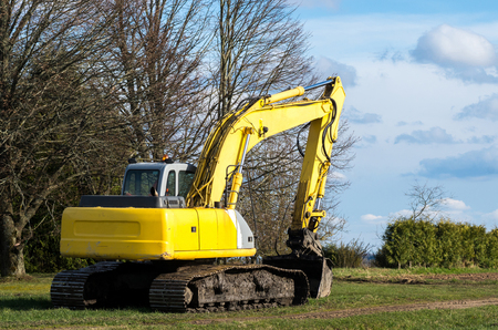dragline: The old excavator stay in the field after works Stock Photo