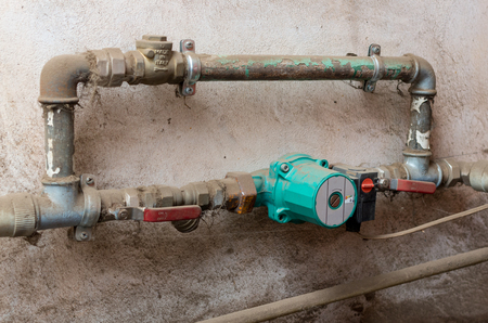 Old circulating pump for water heating systems Stockfoto