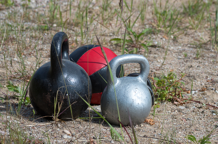 Sports equipment on the sand before workout.