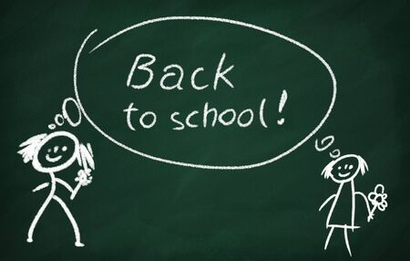 On the blackboard with chalk write back to school