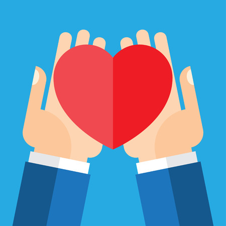 Image of hands holding heart up in clear background