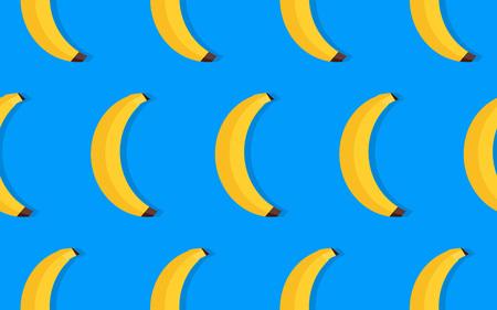 fruit pattern of yellow bananas on blue background.