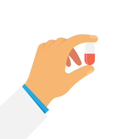 Doctor hand holds pill his fingers. Medical treatment or Healthcare concept.