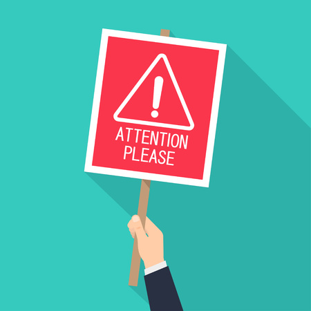Hand holds a banner with an inscription Attention please. Alert signs. Vector illustration.