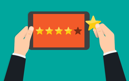 Hand holding and pointing to a tablet with five star on the screen. Rating and review. Customer reviews, rating, classification. Vector Illustration Reklamní fotografie - 114463003