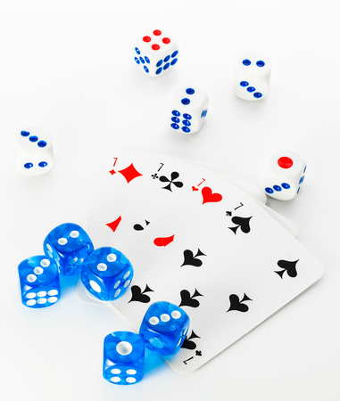 few blue and white dices and cards on white background