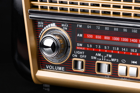 fragment of radio receiver in retro style with radio dial and silver buttons Stock Photo