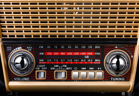 radio receiver in retro style with radio dial and silver buttons