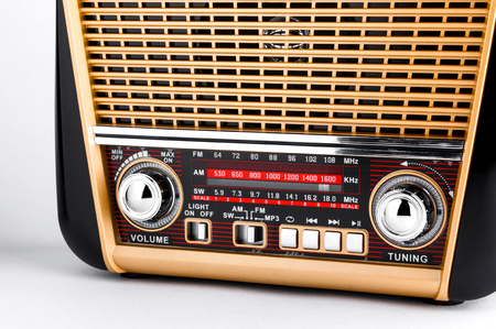 radio receiver in retro style with audio player on white background