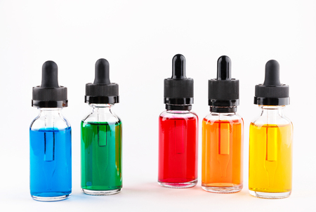 transparent glass bottles filled colored liquid with dropper