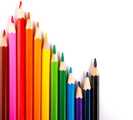 twelve colored pencils wave on white background