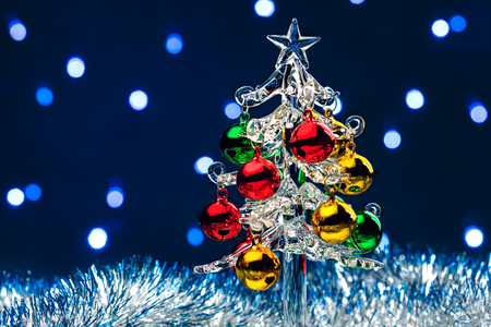 glass christmas tree with colorful balls on blurred lights background stock photo picture and royalty free image image 88476074