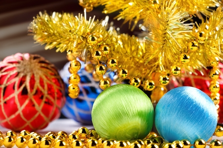 Golden christmas tree with decorated balls and light beams on dark background. Stock Photo