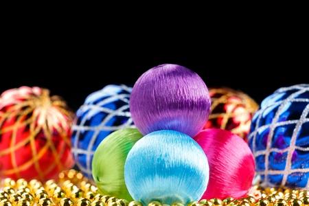 Colored christmas balls on dark background Stock Photo