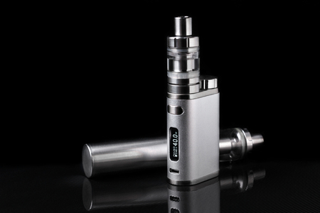 electronic cigarette or vaping device on black background