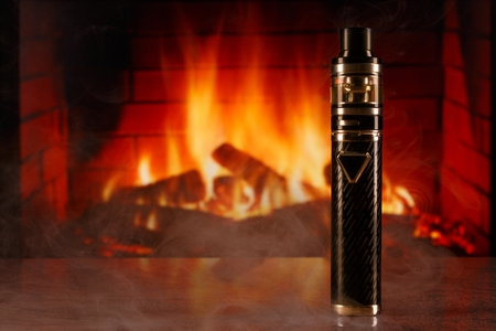 electronic cigarette within vapor on fireplace background