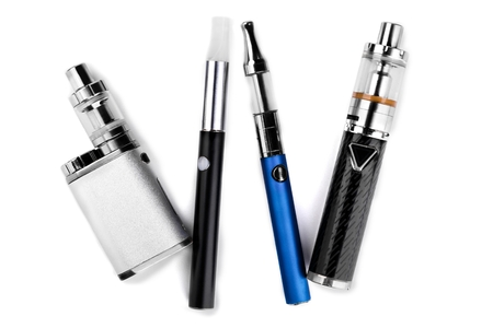 electronic cigarettes or vaping devices on white background Foto de archivo