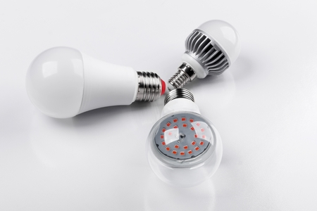 Set with different types of LED bulbs on white background Foto de archivo