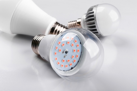 Set with different types of LED bulbs on white background. Selective focus