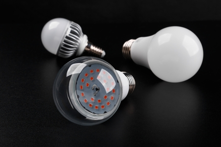 Set with different types of LED bulbs on black background Foto de archivo