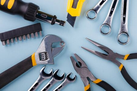 Hand tools kit on blue background. Flat lay.