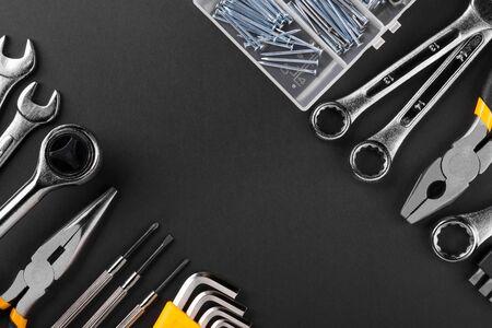 Hand tools kit on black background. Flat lay.