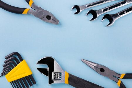 Working tools on blue background. Flat lay. Reklamní fotografie