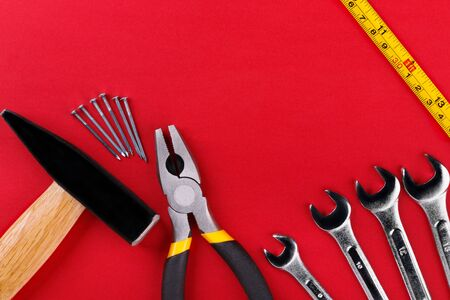 Working tools on red background. Flat lay.