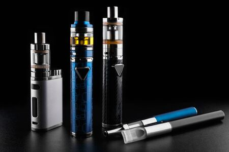 electronic cigarettes or vaping devices on black background Reklamní fotografie