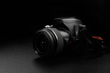 Professional digital slr camera on black background
