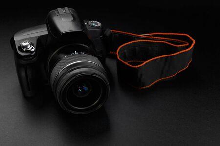 Professional digital slr camera on black background