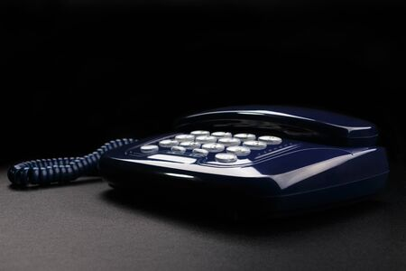 Outdated telephone with push buttons on black background Reklamní fotografie