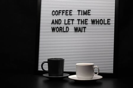 Two cups of coffee and a letter board with inscription. Foto de archivo