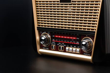 radio receiver in retro style with audio player on black background