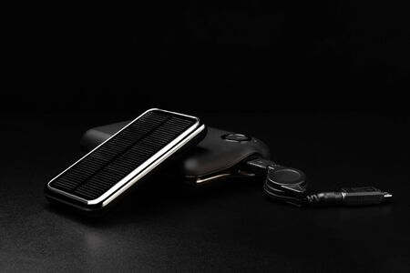 Powerbanks for charging mobile devices on black background