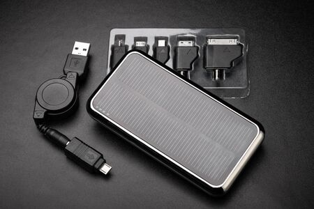 External battery for mobile devices and universal adapters for charger. Concept of energy storage and conservation. Foto de archivo