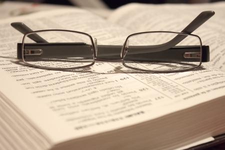 a pair of eyewear resting on a Bible 版權商用圖片