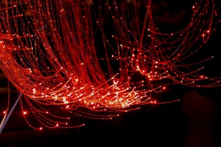 Red Fiber Optic Cable with black background photo